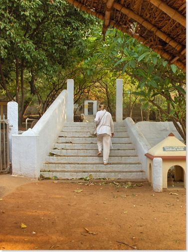 Carol walking through Ramanasramam to path to Skandashram