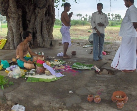 Eldest son doing circle pradakshina