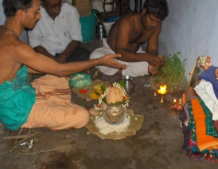 Offering camphor to picuter of mother