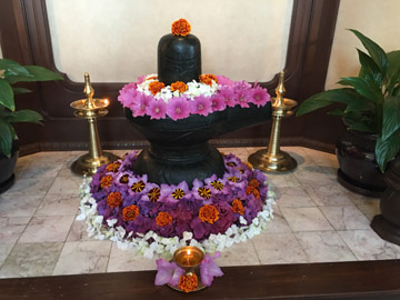 SAT lingam with flowers